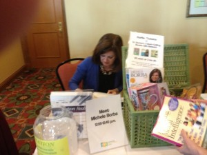 Dr. Michele Borba signing her books.